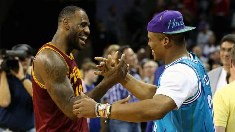 LeBron James and Cam Newton chat courtside | Cavs at Hornets