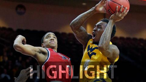 West Virginia holds off Richmond rally, 67-59