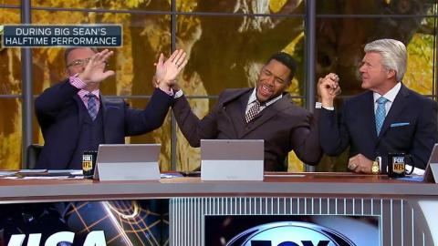 Michael Strahan tries to get Jimmy Johnson to dance to Big Sean